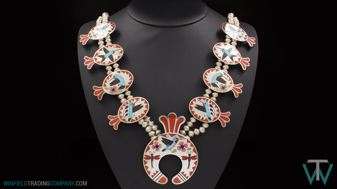 A Gorgeous Finely Detailed Necklace by Zuni artists Rodell and Nancy Laconsello. Amazing inlay work on the Hummingbirds and flowers along with a couple Dragon Flies. i also love the colors! very Spring/Summer. This couple has been making jewelry for several years and do excellent detail work.