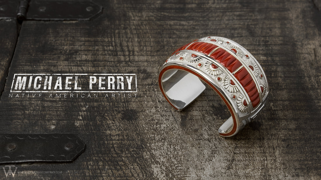 Michael Perry finally brought us one of his Bracelets. Gorgeous! Beautiful modern touches in a old style feel of a design. Great Coral inlay / cobble work along with intricate texture and stamp work.
